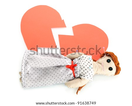 Voodoo doll girl on the broken heart isolated on white - stock photo