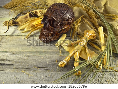 Voodoo still life with human skull, straw doll and copy space - stock photo
