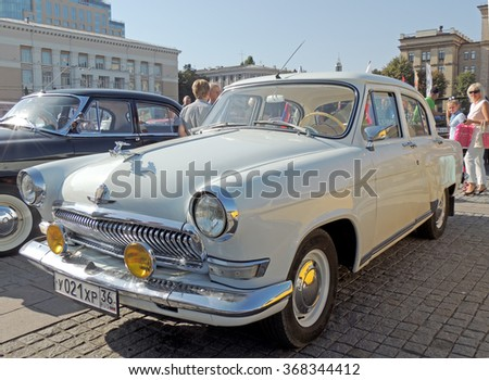 VORONEZH, RUSSIA - September 19, 2015: Soviet retro executive car of 1960s sedan GAZ M21 Volga white on the stone paving city central square during the celebration of the City Day - stock photo