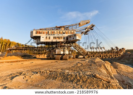 VOSKRESENSK, RUSSIA - SEPTEMBER 20, 2014: Giant stacker (absetzer) Takraf Ers 710 in sand pit near Voskresensk, Russia. The last survived stacker in Moscow region