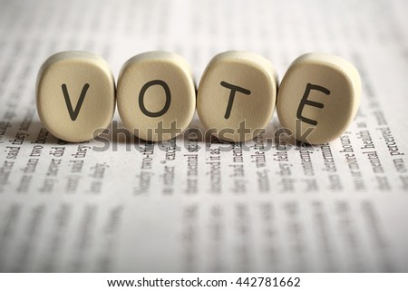 VOTE on newspaper, shallow depth of field image. - stock photo