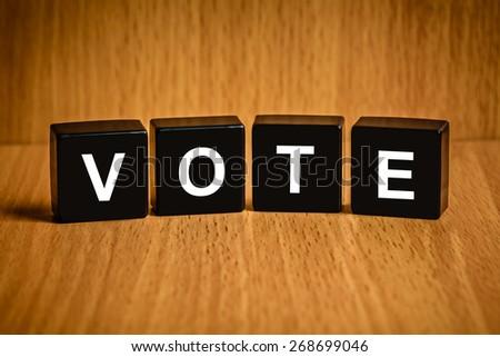 Vote text on black block - stock photo