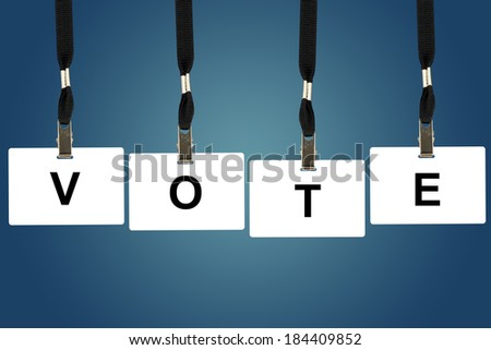 vote word on badge with blue background - stock photo