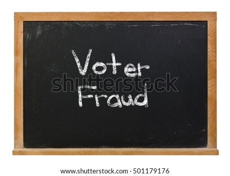Voter fraud written in white chalk on a black chalkboard isolated on white