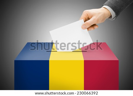 Voting concept - Ballot box painted into national flag colors - Chad - stock photo