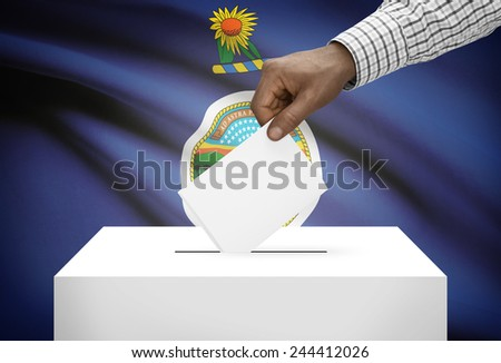 Voting concept - Ballot box with US state flag on background - Kansas - stock photo