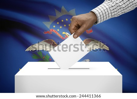 Voting concept - Ballot box with US state flag on background - North Dakota - stock photo