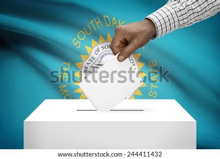 Voting concept - Ballot box with US state flag on background - South Dakota - stock photo