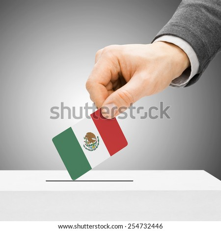 Voting concept - Male inserting flag into ballot box - Mexico - stock photo