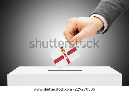 Voting concept - Male inserting flag into ballot box - Northern Ireland - stock photo