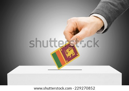 Voting concept - Male inserting flag into ballot box - Sri Lanka - stock photo