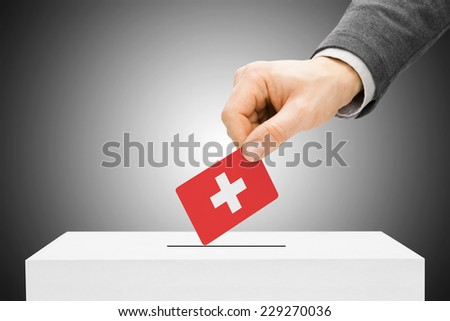 Voting concept - Male inserting flag into ballot box - Switzerland - stock photo
