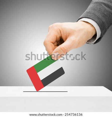 Voting concept - Male inserting flag into ballot box - United Arab Emirates - stock photo