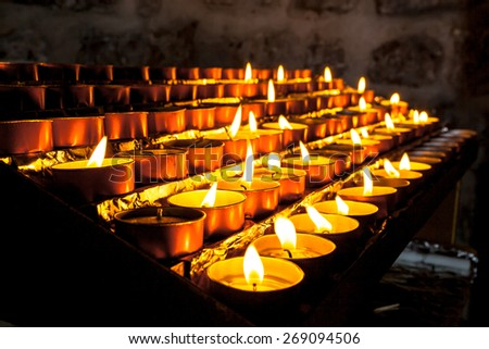 Votive Candles in a Group burnt to pray for Someone Else - stock photo