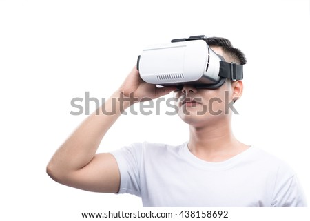 VR Goggles. Man wearing virtual reality goggles watching movies or playing video games isolated on a white background. The vr headset design is generic and no logos. - stock photo