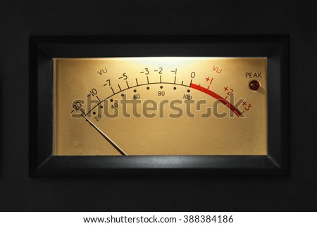 VU Meter on audio equipment,Analog measuring device with the needle in motion, studio closeup - stock photo