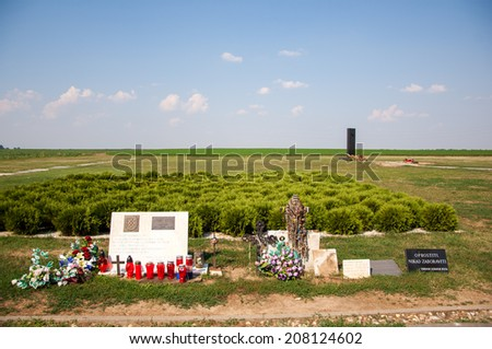 VUKOVAR, CROATIA - July 7, 2014: The memorial area - Ovcara at Vukovar. Monument and rosaries on the cross that mark the site of mass graves.