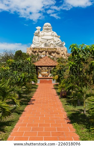 VUNG TAU, VIETNAM - JANUARY 2014: Buddha statue at top of a hill
