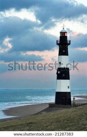 Vuurtoren Breskens lighthouse in the Netherlands, photographed in the dusk - stock photo