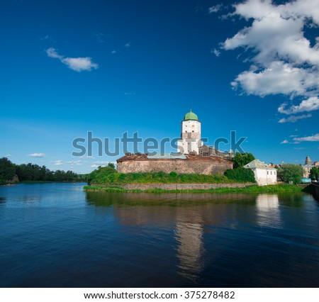 Vyborg Castle (Swedish-built) with Olaf's (st. Olav) Tower. Estuary Vuoksa. Russia - stock photo
