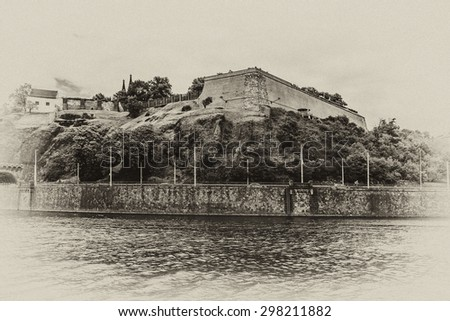 Vysehrad - historical fort located in the city of Prague, Czech Republic. It was probably built in the 10th century, on a hill over the Vltava River. Antique vintage. - stock photo