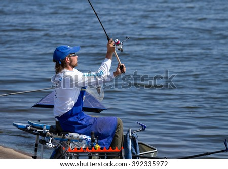 "VYSHGOROD, UKRAINE - JUNE 7, 2014: Fshing competition ""Fishing Feeder Cup of Ukraine"" on the municipal embankment of the Kyiv sea in Vyshgorod , Ukraine"