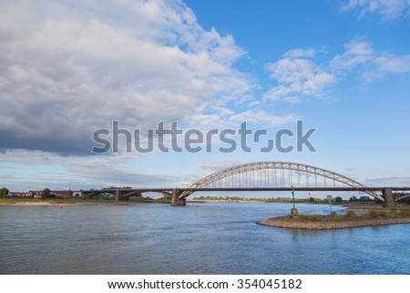 Waal bridge agains cloud and blue sky - stock photo