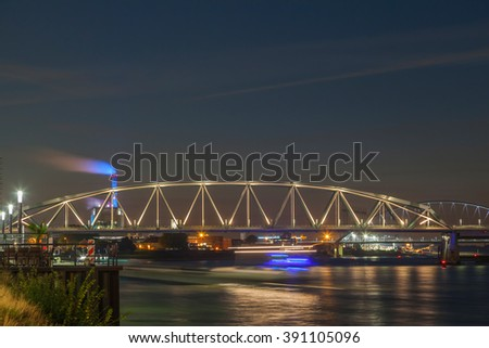 Waal bridge and cityscape at night, Nijmegen, The Netherlands - stock photo
