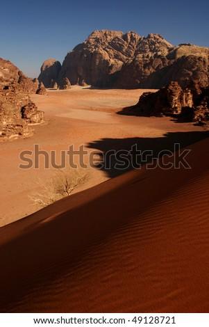 Wadi rum desert from the big red dune - stock photo