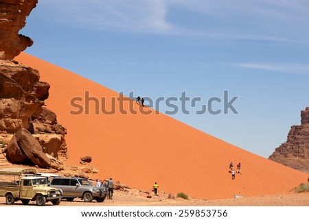 WADI RUM DESERT, JORDAN- APRIL 10, 2014:Sand-dunes in Wadi-Rum desert, Jordan, Middle East    - stock photo