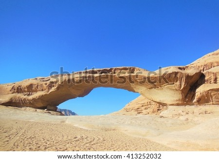 Wadi Rum Desert Rock Bridge in Jordan - stock photo