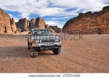 WADI RUM, JORDAN - APR 2, 2015: Off-road car shown in the Wadi Rum desert. Extreme desert safari is one of the main local tourist attraction in Jordan - stock photo