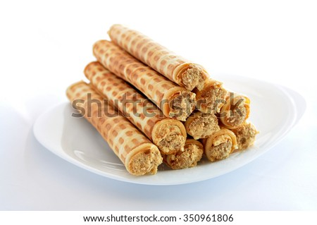 Wafer rolls filled with condensed milk - stock photo