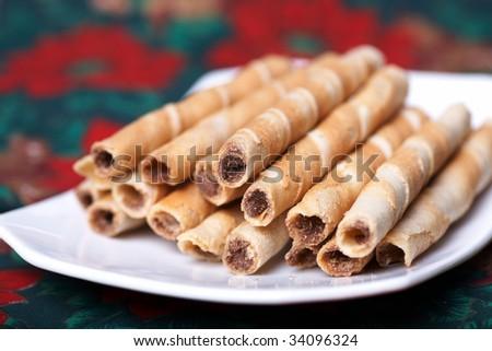 wafer rolls stuffed by chocolate. - stock photo