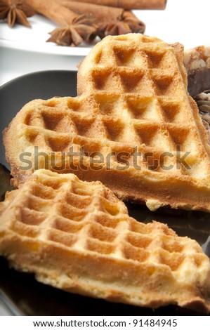 Waffle in heart shape isolated on black - stock photo