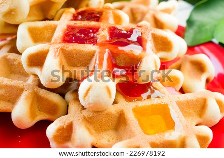 Waffles homemade with honey and raspberry jam - stock photo