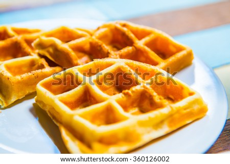Waffles on white plate, Thailand. - stock photo