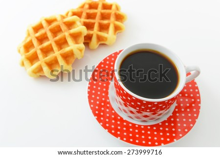 Waffles with a cup of coffee - stock photo