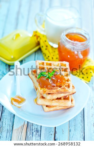 waffles with apricot jam on the plate - stock photo
