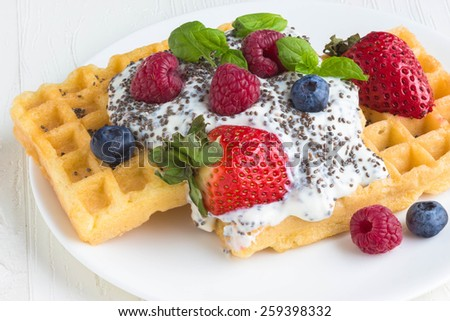 Waffles with  chia seeds, fresh berries and cream, selective focus - stock photo