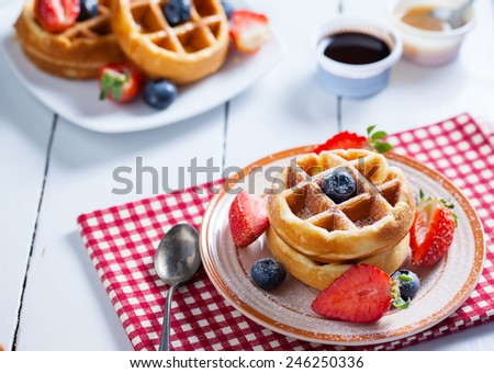 waffles with strawberry,blueberry and caramel sauce - stock photo