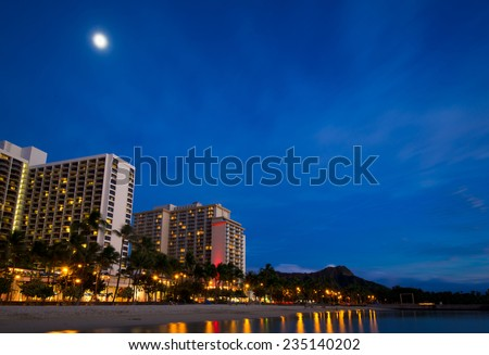 Waikiki at night with Diamond Head in background and moonlight - stock photo