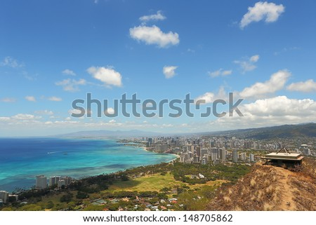 Waikiki Beach and Honolulu, Hawaii with the surrounding hotels as seen from the top of Diamond Head crater - stock photo