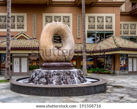 WAIKIKI, HAWAII - APRIL 25: Sculpture and fountain on the grounds of the Hilton Hawaiian Village on April 25, 2014 in Waikiki, Hawaii. The Hilton Hawaiian Village is one of the main Waikiki hotels.  - stock photo