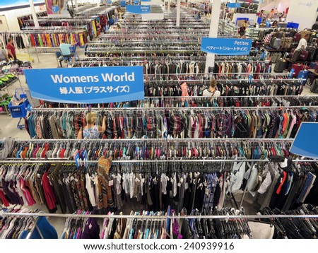 WAIKIKI, HI - NOVEMBER 8: People explore aisle of clothes at Ross store with signs in English, Japanese November 8 2014, Oahu, Hawaii.  Ross Stores is American chain of off-price department stores. - stock photo