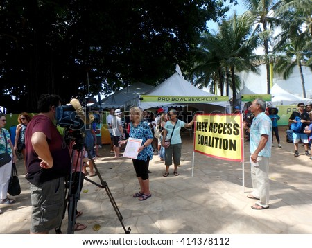 WAIKIKI - JANUARY 30: Woman of Free Access Coalition protest Pro Bowl Beach Party talking to cameras on Queens Beach in Waikiki, Hawaii January 30, 2016. - stock photo