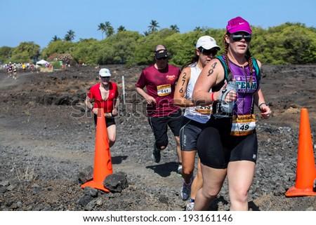 WAIKOLOA, USA - APRIL 3, 2011: Unidentified runner on the Lavaman Triathlon in Waikoloa, Hawaii. It is held in Olympics format: 1.5 km swimming, 40 km biking and 10 km running. - stock photo