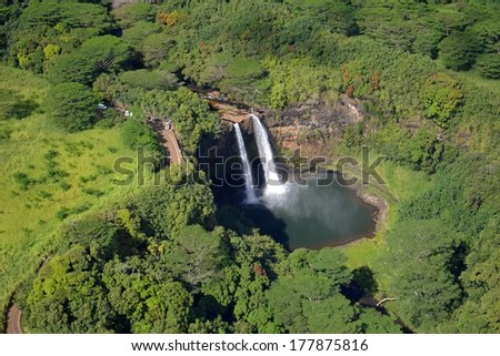wailua falls in kauai, hawaii as seen from a helicopter - stock photo