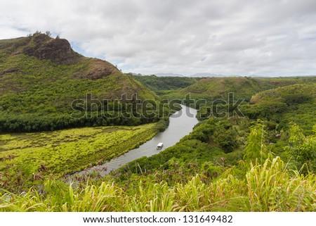 Wailua river with a boat in Kauai, Hawaii - stock photo