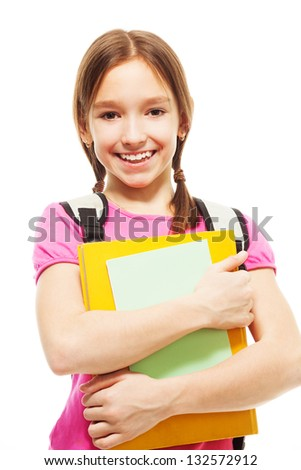 Waist up portrait of cute teenage girl with pile of books - stock photo
